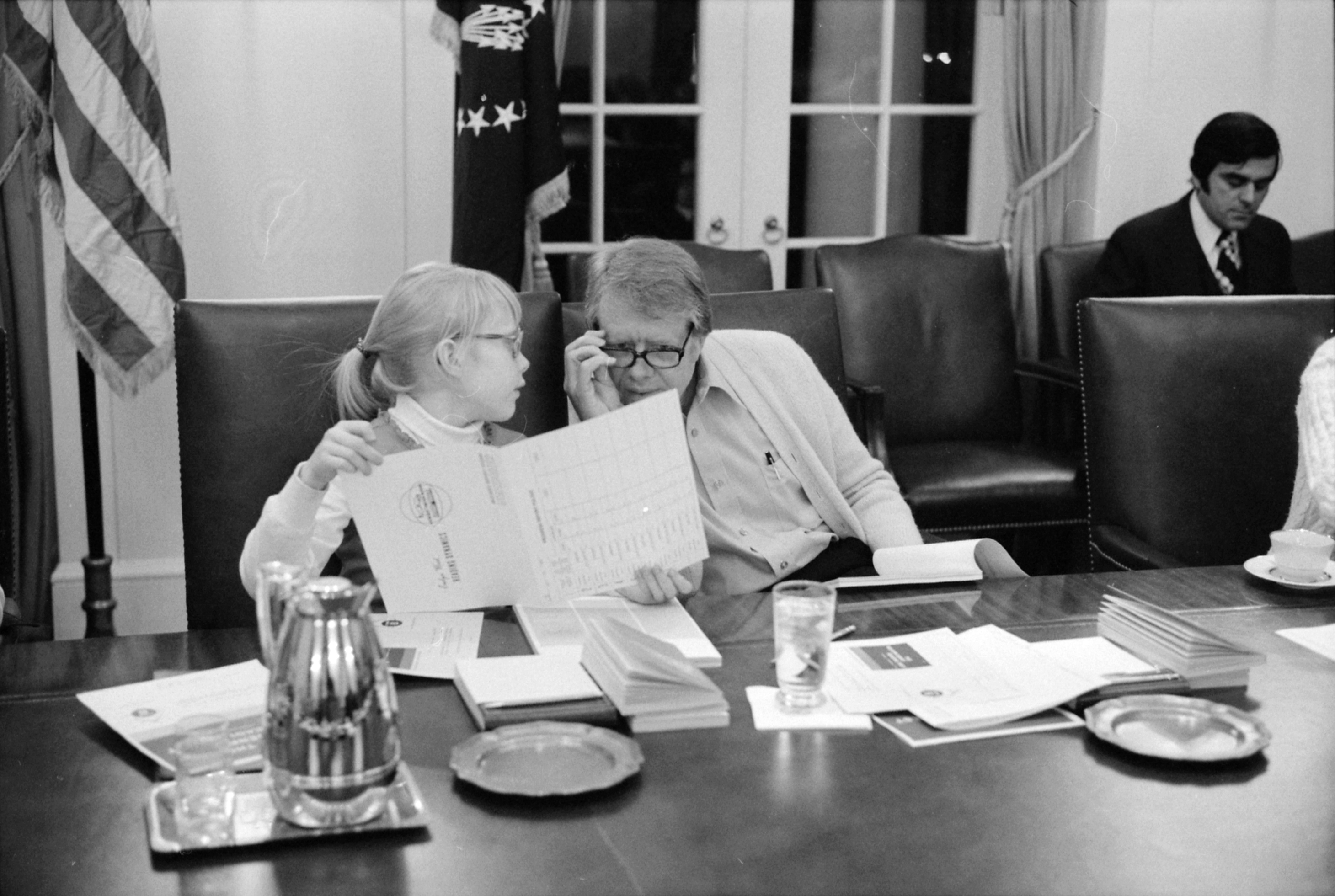 Amy Carter and Jimmy Carter participate in a speed reading course at the White House.